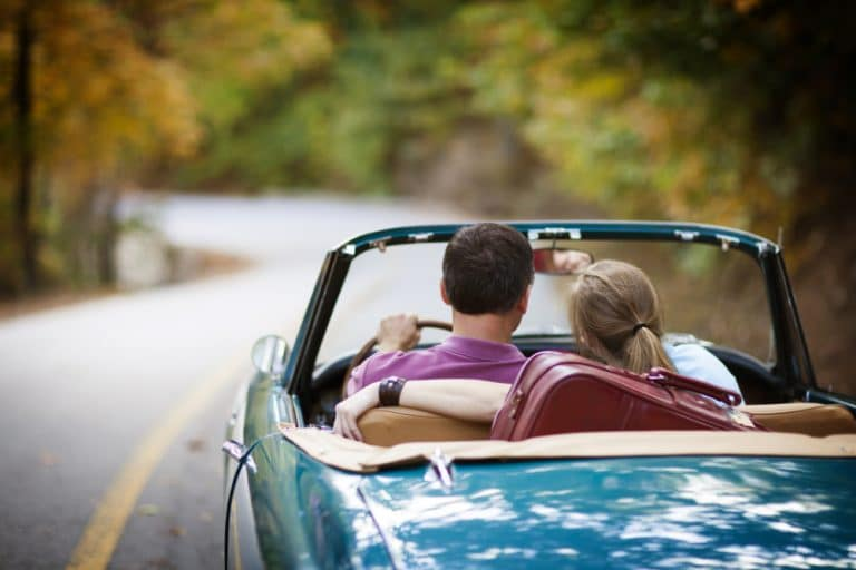 photo of married couple driving